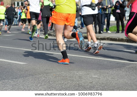 Marathon running race, many runners feet on road, sport, fitness and healthy lifestyle concept  #1006983796