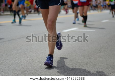 Marathon running race, many runners feet on road, sport, fitness and healthy lifestyle concept  #649282588
