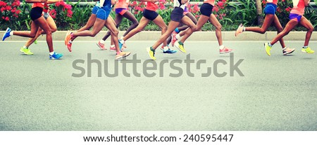 Photo of  Marathon running race, people feet on city road