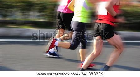 Marathon running race, people feet on city road  #241383256