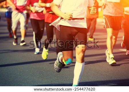 Marathon running race, people feet on city road  #254477620