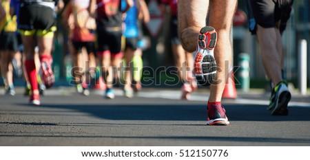Marathon running race, people feet on city road #512150776