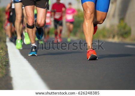 Marathon running race, people feet on city road #626248385