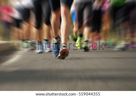 Marathon running race people feet on city road,abstract #559044355