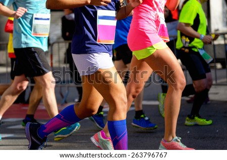 Marathon running race, people feet on road, women run,  sport, fitness and healthy lifestyle concept