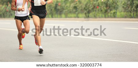 Marathon running race, people  on city road #320003774