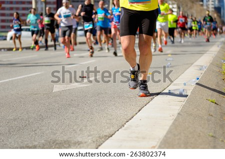 Marathon running race, runners feet on road, sport, fitness and healthy lifestyle concept  #263802374