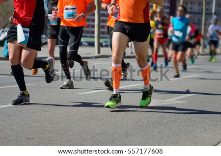 Marathon running race, runners feet on road, sport, fitness and healthy lifestyle concept  #557177608