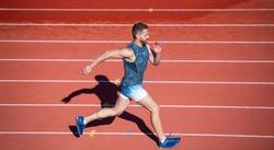 marathon speed. sprinter. energetic man on running track. sporty runner. stamina.