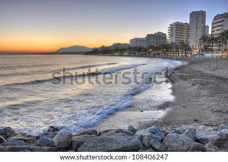 Marbella beach surprised at sunset. Marbella is one of the most important tourist cities of the Costa del Sol and throughout most of the year is an international tourist attraction.