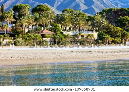 Marbella sandy beach coastline summer holiday scenery by the Mediterranean Sea in Spain, Andalusia region, Costa del Sol, Malaga province.