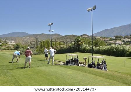 MARBELLA, SPAIN - MAY 30: Golf players on May 30, 2014 at La Quinta golf,  in Marbella, Spain. Gof players prepared to strike at the tee.