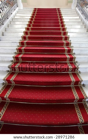 Marble a step covered by a red carpet