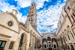 Marble ancient roman architecture in city center of town Split, view at square Peristil in front of cathedral Saint Domnius and  bell tower landmarks, Croatia. / Selective focus.