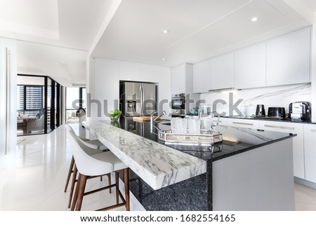 Marble benchtop with a black granite benchtop Stockfoto ©