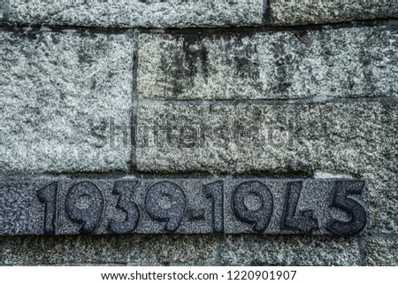 Marble block with the dates of the Second World War engraved on it.  1939 - 1945