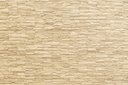Marble brick stone tile wall texture background in light beige yellow cream color