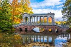 Marble bridge in golden fall in Catherine park, Tsarskoe Selo, Saint Petersburg, Russia