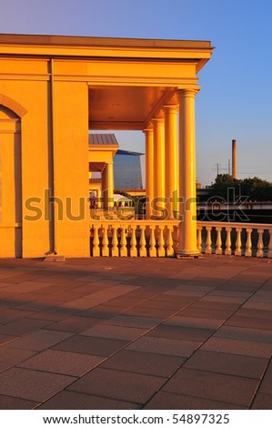 Marble building bathed in gold light at Philadelphia water works