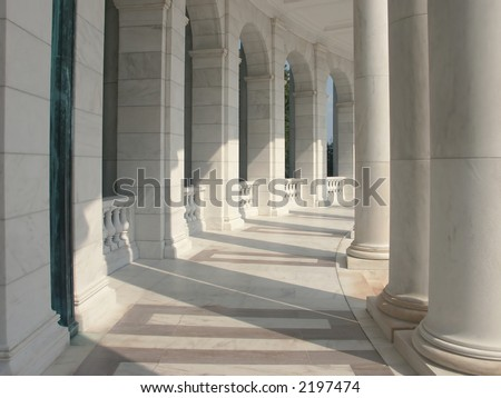 Marble Columns - a curved row of pillars joined with an elegantly carved baluster.