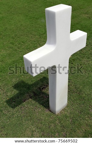 Marble cross in a military cemetery