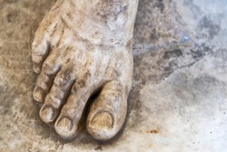 Marble foot of the sculpture close up. The attraction of the Museum.