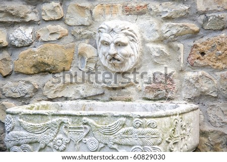 marble fountain with face