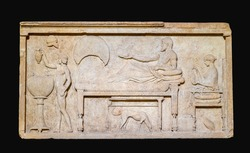 Marble funerary stele with a banquet scene from Thassos (Greek).