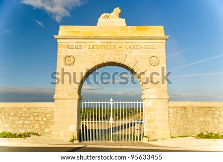 Marble gate in the shape of arc to Chateau Leoville-Lascases vineyard in region Medoc, Bordeaux, France