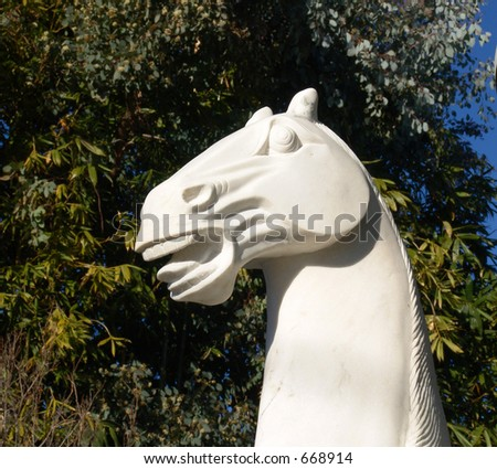 Marble Horse on a gate post in Southern California - stock photo
