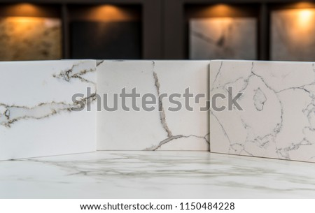 Marble kitchen white carrara counter top samples in the store on the marble slab