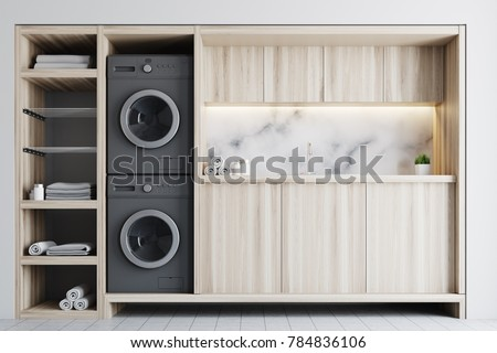 Marble laundry room interior with wooden countertops, a closet and built in washing machines. 3d rendering mock up #784836106