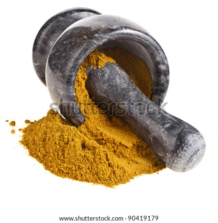 marble mortar with  curry powder  isolated on white