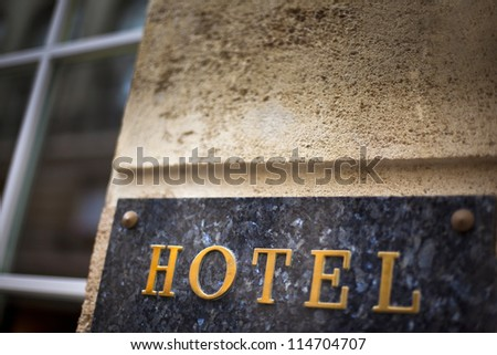 Marble plaque on the facade of a hotel