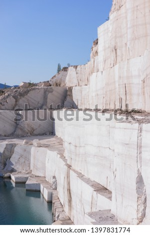 Marble quarry landscape in the mountains with a turquoise lake water #1397831774