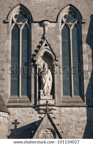 marble sculpture and windows at Saint John's cathedral in Limerick, Ireland (blue sky background)