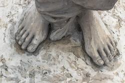 Marble sculpture depicting Jesus' feet.
