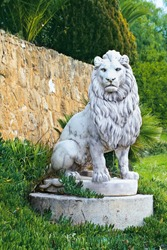 marble sculpture of a lion at the wall