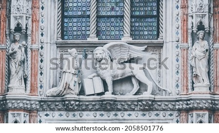 marble sculpture of bishop and lion with wings