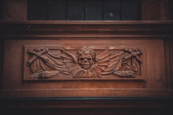 Marble skull and wings on the wall in the Catholic church