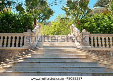 Marble stairs in the green tropical park