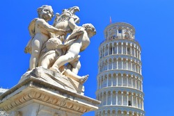 Marble statue in front of the Leaning Tower of Pisa in Piazza dei Miracoli (Square of Miracles), Pisa, Tuscany, Italy