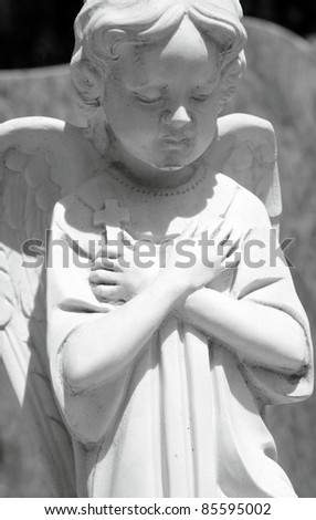 marble statue  of angel  holding a cross on Monumental cemetery of Staglieno, Genoa, Italy, Europe