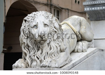 "marble statue of lion (dated about 1830) outside the cathedral of Genova. The lion is a mammal also known as the ""king of the jungle"". For this reason it is a symbol of fortress, royalty, bravery, ... #1008090148"