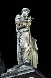 Marble statue of Saint Peter at night. Vatican city