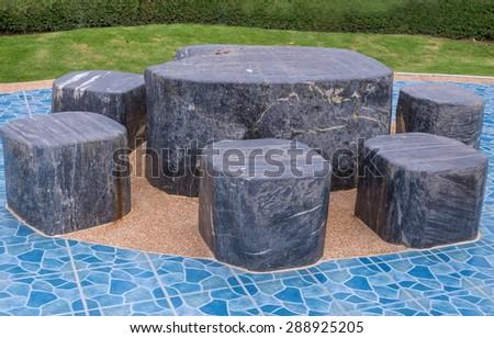 Marble stone garden bench in the public park. #288925205