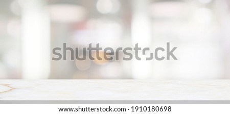 marble table top with blurred abstract cafe restaurant interior background