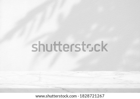 Marble Table with Leaves Shadow on Stucco Wall Texture Background, Suitable for Product Presentation Backdrop, Display, and Mock up.