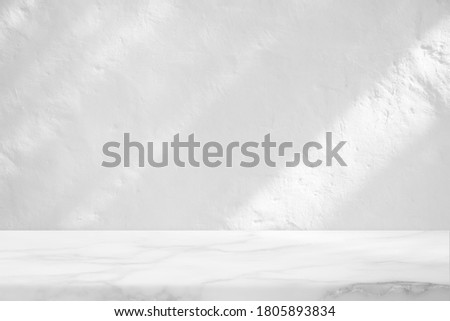 Marble Table with White Stucco Wall Texture Background with Light Beam and Shadow, Suitable for Product Presentation Backdrop, Display, and Mock up.