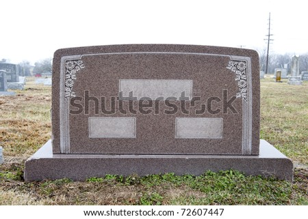 Marble tombstone with places to write two individuals' names and their common last name